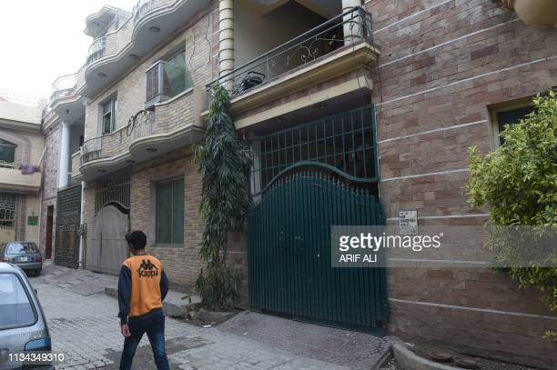In this picture taken on March 13 a Pakistani boy walks past the house where 16yearold Uzma worked as a maid in Lahore before being killed and dumped...