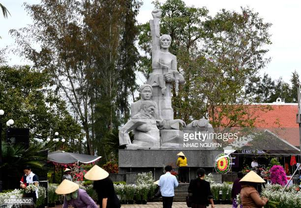 In this picture taken on March 15 workers prepare the grounds of the war memorial for victims of the My Lai massacre in Son My village, Quang Ngai...