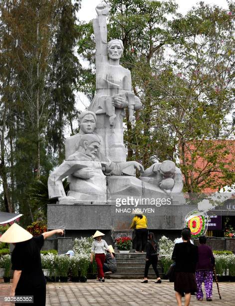 In this picture taken on March 15 workers prepare the grounds of the war memorial for victims of the My Lai massacre in Son My village Quang Ngai...