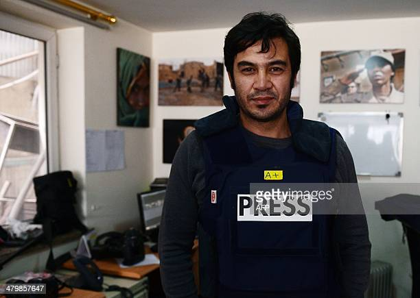 In this picture taken on March 20 Sardar Ahmad a Kabul based staff reporter at the Agence FrancePresse news agency poses for a photo at the AFP...