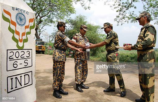 In this picture taken on March 26 Bangladesh Rifles personnel and Indian Border Security Force personnel greet each other with sweets at The Akhaura...