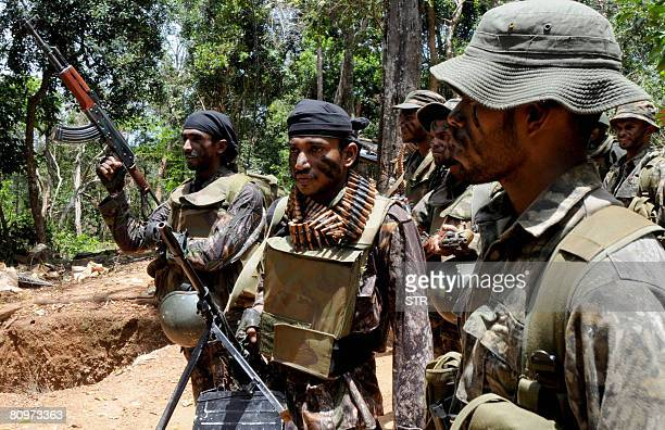 In this picture taken on March 27 Sri Lanka army soldiers take up position in the northeastern region of Weli Oya At least seven combatants have been...