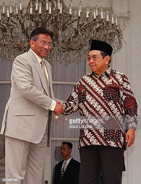 In this picture taken on March 30 then Indonesian President Abdur Rahman Wahid shakes hands with visiting Pakistani Military General Pervez Musharraf...