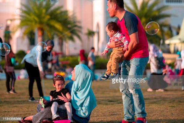 In this picture taken on March 31 2019 shows families gather at Taman Mahkota Jubli Emas park in Bandar Seri Begawan The United Nations decried on...
