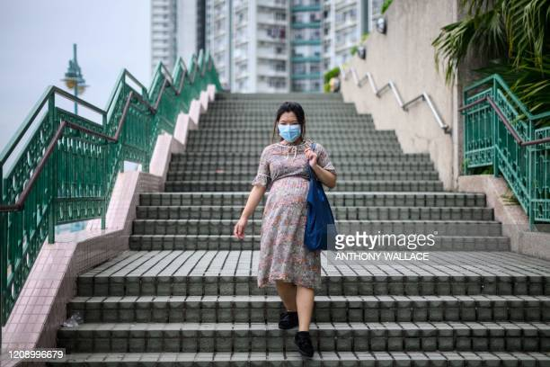 In this picture taken on March 31 expectant mother Jamie Chui takes a walk near where she lives in Hong Kong. - Jamie Chui has been a virtual...