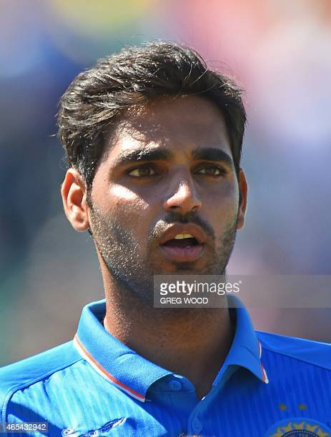 In this picture taken on March 6 India's Bhuvneshwar Kumar listens to the national anthem prior to the start of the 2015 Cricket World Cup Pool B...