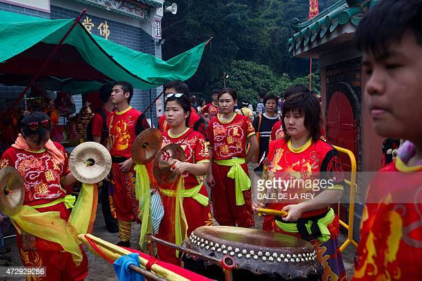 In this picture taken on May 10 members of a lion dance team perform at Joss House temple to celebrate the Tin Hau festival in Hong Kong Worshippers...