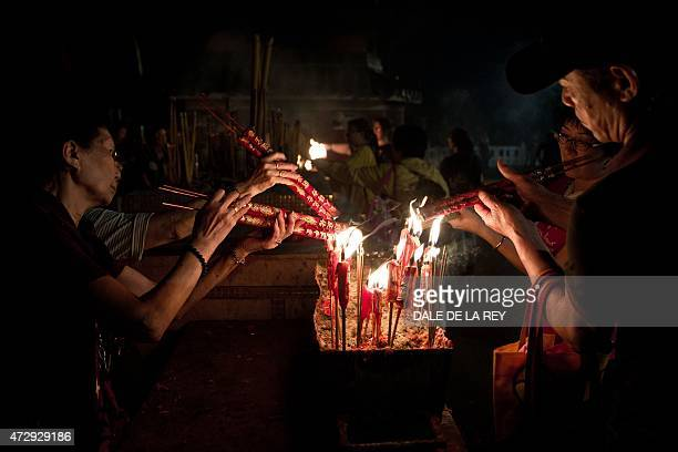 In this picture taken on May 10 people burn incense sticks at Joss House temple to celebrate the Tin Hau festival in Hong Kong Worshippers visit...