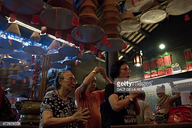 In this picture taken on May 10 people pray at Joss House temple to celebrate the Tin Hau festival in Hong Kong Worshippers visit temples throughout...