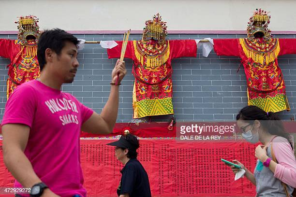 In this picture taken on May 10 people visit Joss House temple to celebrate the Tin Hau festival in Hong Kong Worshippers visit temples throughout...