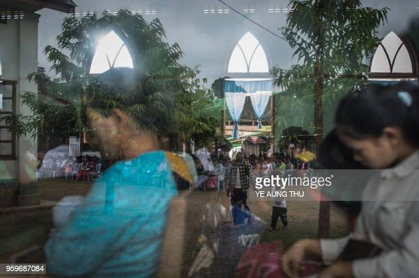 In this picture taken on May 13 internally displaced people and local villagers attend a church service in Myitkyina Kachin state Often called the...