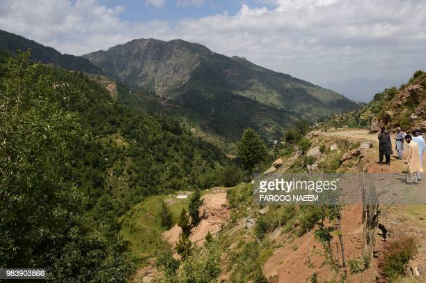 In this picture taken on May 18 officers of the Khyber Pakhtunkhwa forest department overlooks a forest area in Swat valley in northwest Pakistan The...