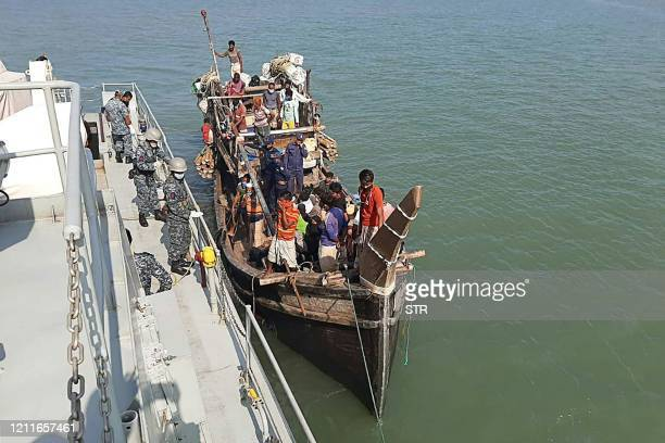 In this picture taken on May 2 Rohingya refugees stranded at sea are seen on a boat near the coast of Cox's Bazar Dozens of Rohingya refugees...