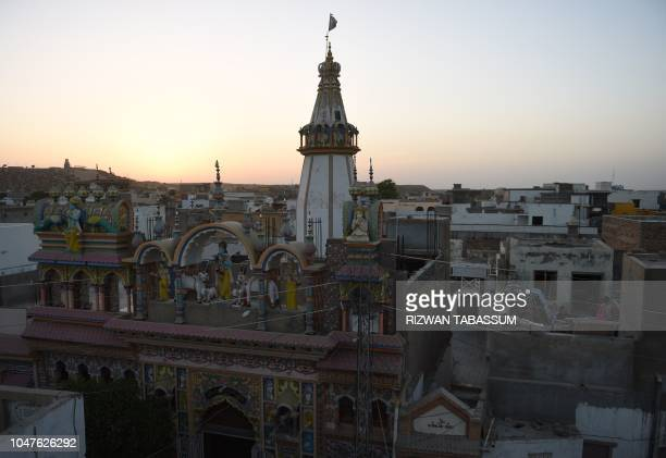 In this picture taken on May 24 a view of Hindu Shri Krishna Temple is pictured in Mithi some 320 km from Karachi Cows roam freely in the Pakistani...