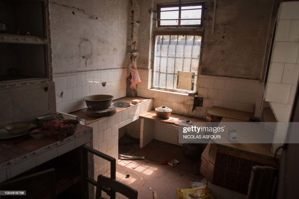 In this picture taken on May 29, 2018, kitchen utensils left behind by former residents are seen inside an apartment in Chikan village in Kaiping. - Several dozen inhabitants of a historic section of the town of Chikan in southern China are stubbornly holding out against government pressure to sell their properties to make way for a 'heritage' theme park. Chikan was listed as a UNESCO World Heritage Site in June 2007 due to its 19th- and early 20th-century houses, which feature a unique mix of European and Chinese architecture, clock towers and intricate stone wall carvings. (Photo by NICOLAS ASFOURI / AFP) / TO GO WITH China-migration-rights-tourism,FEATURE by Joanna Chiu