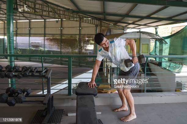 In this picture taken on May 6, 2020 Moldovan tennis player Dmitrii Baskov lifts weights during a workout at the Ace Tennis Academy during nationwide...