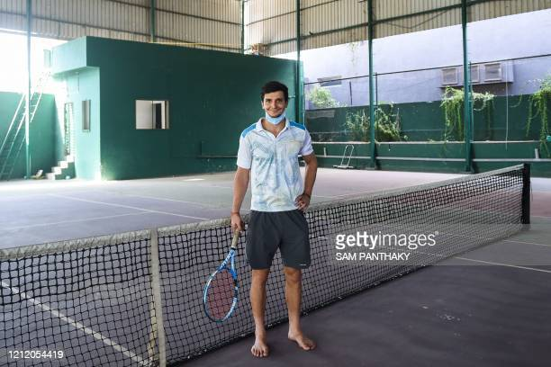 In this picture taken on May 6, 2020 Moldovan tennis player Dmitrii Baskov poses for a picture at the Ace Tennis Academy during nationwide lockdown...