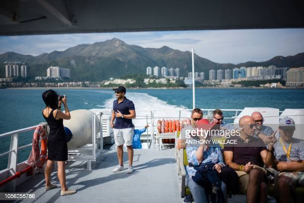 In this picture taken on November 1 commuters take a ferry from the residential district of Discovery Bay on Hong Kong's outlying Lantau Island.