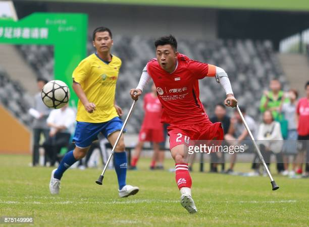 TOPSHOT In this picture taken on November 12 He Yiyi kicks the ball during a football match with a local team in Guangzhou Guangdong province The...