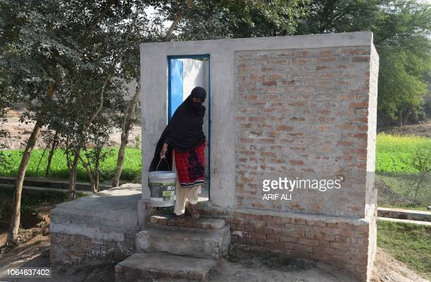 TOPSHOT In this picture taken on November 15 a Pakistani woman comes out from a toilet in Basti Ameerwala village in central Punjab province For as...