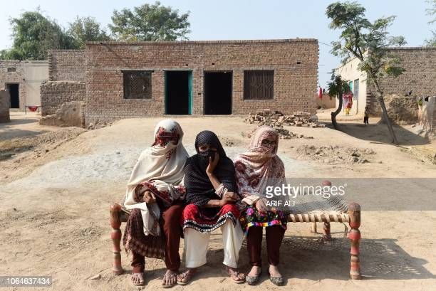 TOPSHOT In this picture taken on November 15 Pakistani women give an interview to AFP in Basti Ameerwala village in central Punjab province For as...