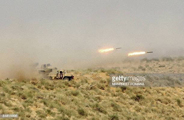 In this picture taken on November 18 Indian troops fire Multibarrel Rocket Launchers during the 'Operation Desert Strike' Exercise at Pokhran some...