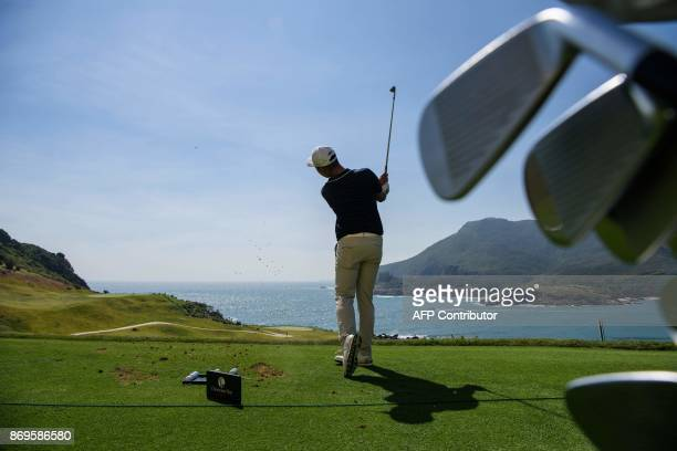 In this picture taken on November 2 Chinese golfer Lin Yuxin warms up on the driving range prior to teeing off at the first hole of the Clearwater...