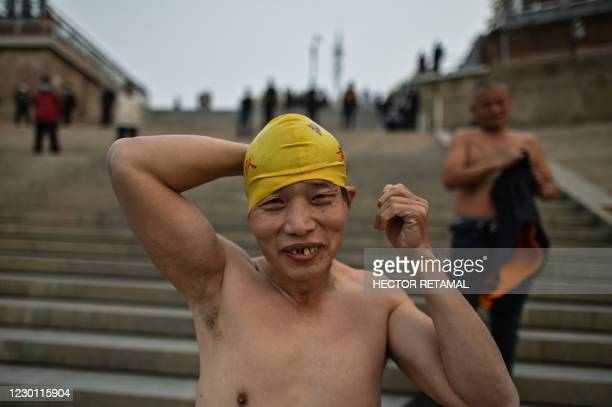 In this picture taken on November 20 a man prepares to swim in the Yangtze River in Wuhan, in Chinas central Hubei province. - The riverbank is...