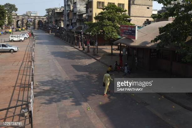 In this picture taken on November 21, 2020 a general view of a partially deserted market area is pictured after a curfew was imposed as a preventive...