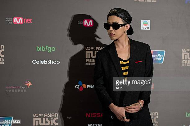 In this picture taken on November 22 Big Bang's GDragon who won best artist and best male solo dance performance attends a press conference ahead of...