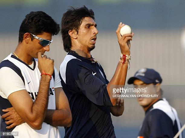 In this picture taken on November 25 Indian cricketer Ishant Sharma is watched by fielding coach Robin Singh and bowling coach Venkatesh Prasad...