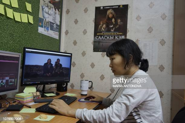In this picture taken on November 29 2018 Yakutian filmmaker Lyubov Borisova works on her film in Sakhafilm production studio office in Yakutsk In...