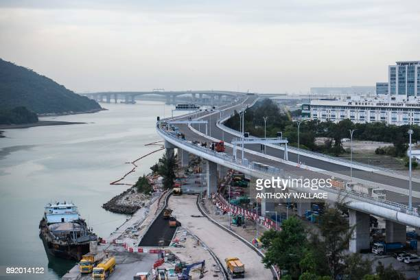 In this picture taken on November 29 a general view shows a section of the Hong KongZhuhaiMacau Bridge that runs alongside the international airport...