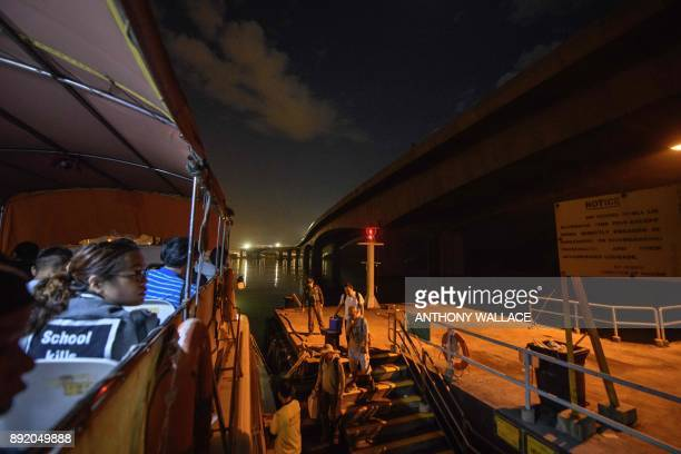 In this picture taken on November 29 commuters prepare to board a ferry underneath a section of the Hong KongZhuhaiMacau Bridge in Hong Kong Billed...