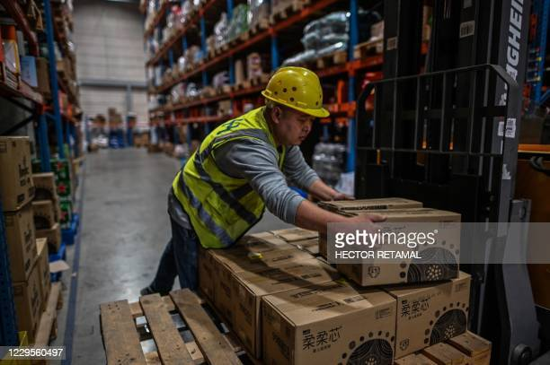 In this picture taken on November 6 an employee works in the warehouse of Cainiao Smart Logistics Network, the logistics affiliate of e-commerce...