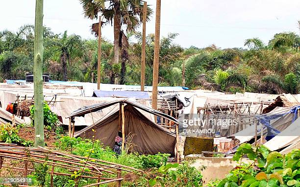 In this picture taken on October 10 2011 people go about their business a refugee camp of Ivorian refugees in the Ghanian town of Ampan The 10...