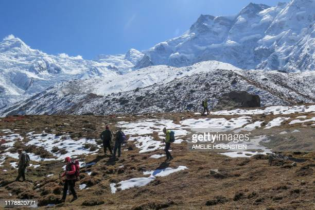 In this picture taken on October 13 foreign tourists and their guides trek down from Nanga Parbat base camp Such was the determination of Nepali...