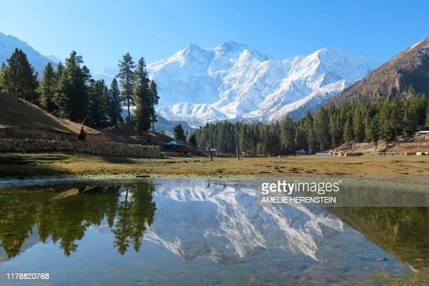 In this picture taken on October 13 Nanga Parbat mountain is seen reflecting in a pond at Fairy Meadows tourist village Such was the determination of...