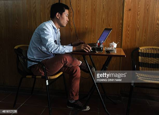 In this picture taken on October 15 a man uses a laptop inside a coffee shop in downtown Hanoi Vietnam's Prime Minister Nguyen Tan Dung has conceded...
