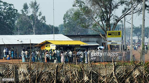 In this picture taken on October 22 ethnic minority Sri Lankan Tamils queue at a Western Union money transfer counter situated inside a camp for...