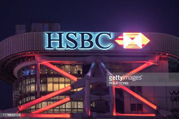 In this picture taken on October 24 shows a general view of the HSBC headquarters building in Hong Kong. - HSBC pre-tax profits slip 18 percent to...
