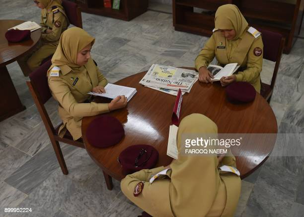 In this picture taken on October 25 a Pakistani cadet read books in a library at the Pakistan Army's first Girls' Cadet College in Mardan At a...