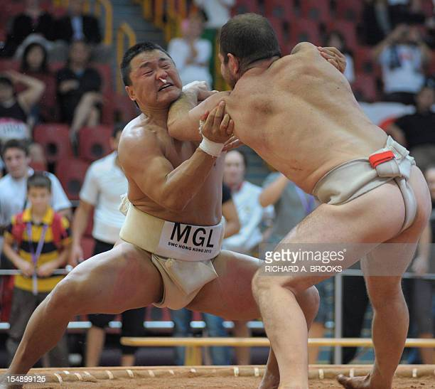 In this picture taken on October 28 Gantugs Rentsendorj of Mongolia fights off against Stiliyan Georgiev of Bulgaria in the final of the men's...