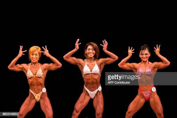 In this picture taken on October 9 Japanese bodybuilders Satoko Yamanouchi Megumi Sawada and Naoko Osawa pose during the Japan bodybuilding...