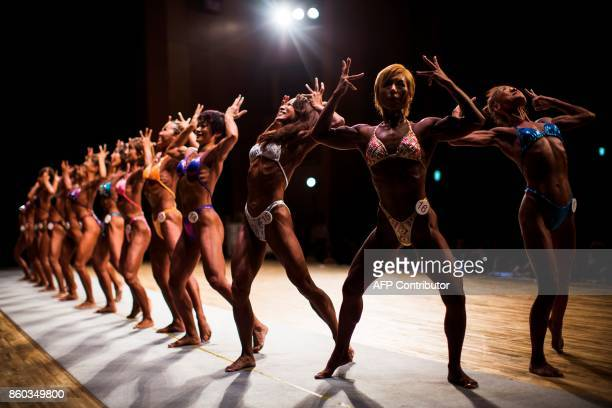 TOPSHOT In this picture taken on October 9 Japanese women bodybuilders pose during the Japan bodybuilding championships in Tokyo The number of...