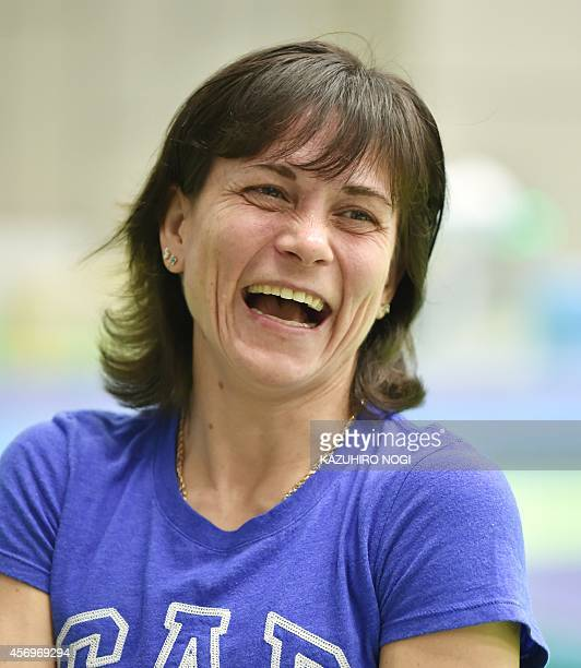 In this picture taken on October 9 Uzbek gymnast Oksana Chusovitina smiles during an interview after her training session at the Gymnastics World...