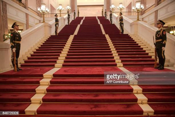 In this picture taken on September 13 2017 Chinese military guards are seen inside the Great Hall of the People in Beijing Chinese President Xi...