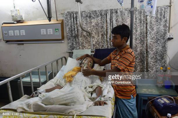 In this picture taken on September 13 Rohingya Muslim refugee Sadekun Nahar is tended to by her son as she is treated in hospital after being injured...