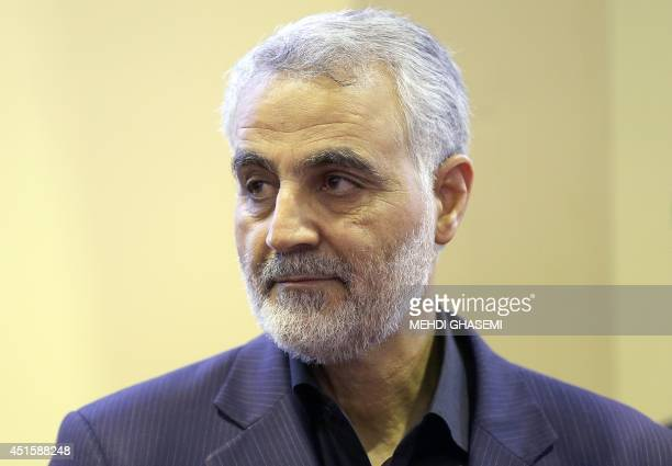 In this picture taken on September 14 the commander of the Iranian Revolutionary Guard's Quds Force Gen Qassem Soleimani is seen as people pay their...