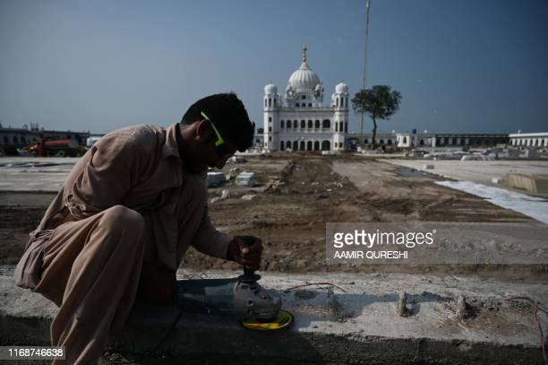 In this picture taken on September 16 2019 a man works on the construction site at the Sikh religious site Gurdwara Darbar Sahib in the Pakistani...